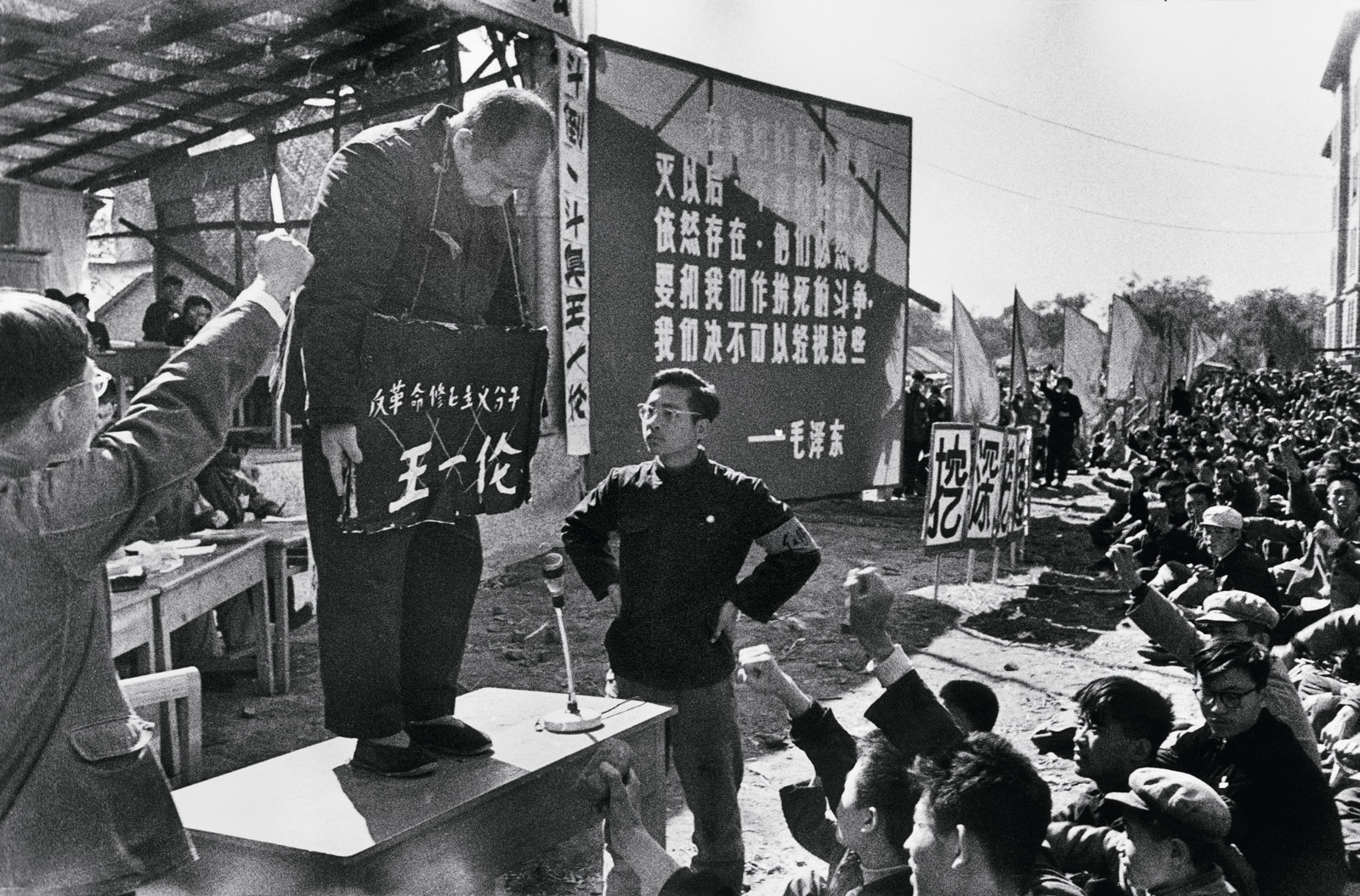 Fascists from the Chinese Communist Party shame a man during the Cultural Revolution